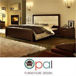 מיטה זוגית מעוצבת עם גב מרופד